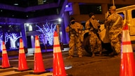 National Guard personnel and police secure a street near the Capitol, Sunday, Jan. 17, 2021, in Washington, as part of…