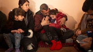 In this Feb. 12, 2020 photo, Malak Saad Dakhel, an 11 year-old Yazidi, is overwhelmed by journalists and well-wishers as her…