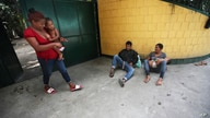 Honduran migrants with children, who are making their way north to the U.S. border, rest in Tecun Uman, Guatemala, Wednesday,…