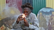 FILE - In this Aug. 28, 2014 file photo, legalization advocate and reggae legend Bunny Wailer smokes a pipe stuffed with…