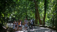 Visitors stroll and pedal at the Tijuca National Park in Rio de Janeiro, Sunday, Feb. 28, 2021. Jackfruit, an invasive species…