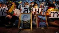 Myanmar nationals living in Thailand attend a candle light vigil as they protest against the military coup in front of the…