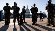 Members of the Michigan National Guard and the U.S. Capitol Police keep watch as heightened security remains in effect around…