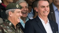 Brazil's President-elect Jair Bolsonaro, right, and Gen. Walter Souza Braga Netto, smile during a ceremony marking the 73 rd…