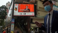 A TV screen broadcasts the news of the opening session of China's National People's Congress (NPC), in Hong Kong, Friday, March…
