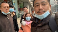 In this photo taken by Ren Quanniu, Ren Quanniu, right, and other supporters of lawyer Lu Si Wei pose for a group photo in…