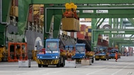 Containers are loaded and unloaded from ships at the port of Sines, in Sines, southern Portugal, Feb. 12, 2020. (AP Photo…