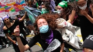 Women shout during a march ahead of International Women's Day in Quito, Ecuador, Sunday, March 7, 2021. (AP Photo/Dolores Ochoa)