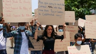 Anti-coup protesters hold slogans calling the attention of an ASEAN regional meeting during a rally on Tuesday April 20, 2021…