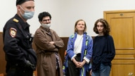 DOXA magazine editors from left, Armen Aramyan, Natalya Tyshkevich and Alla Gutnikova wait for a court session as a police…