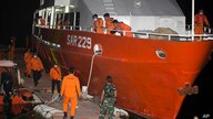 Members of National Search and Rescue Agency (BASARNAS) prepare for a search mission for The Indonesian Navy submarine KRI…