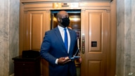 FILE - In this Feb. 13, 2021, file photo, Sen. Tim Scott, R-S.C., departs Capitol Hill in Washington. Scott will deliver…