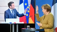 German Chancellor Angela Merkel waves to French President Emmanuel Macron at the end of a press conference following  German…