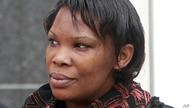 FILE- In this April 12, 2012 file photo Beatrice Munyenyezi leaves the Federal Court in Concord, N.H.   Munyenyezi, who served…