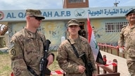 FILE - In this March 27, 2020 file photo, U.S. soldiers stand guard during the hand over ceremony of Qayyarah Airfield, Iraqi…