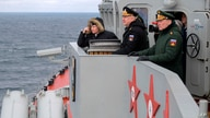 Russian President Vladimir Putin, left, Commander-in-Chief of the Russian Navy Nikolai Yevmenov, second right, and Commander of…