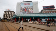 "A man walks under a poster advertising the TV Series ""Zero"", at Cadorna square in Milan, Italy, Tuesday, April 27, 2021. The…"