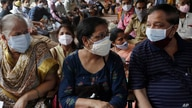 People wait to receive vaccine for COVID-19 outside a vaccination centre in Mumbai, India, Thursday, May 13, 2021. (AP Photo…