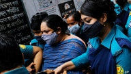 Bangladeshi journalist Rozina Islam, center, is escorted by police to a court in Dhaka, Bangladesh, Tuesday, May 18, 2021…