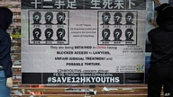 FILE - In this Sept. 29, 2020, file photo, university students put up posters to demand of releasing the 12 Hong Kong activists…
