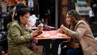 People eat tables outside a restaurant in Chinatown, London, Tuesday, May 18, 2021. For the first time in months, people across…