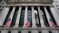 FILE - The New York Stock Exchange is seen in New York, Monday, Nov. 23, 2020.  On Wednesday, April 28, President Joe Biden is…