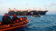 In this handout photo provided by the Philippine Coast Guard, members of the Philippine Coast Guard use rubber boats as they…