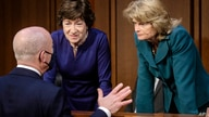 Homeland Security Secretary Alejandro Mayorkas, left, talks with Sen. Susan Collins, R-Maine, center, and Sen. Lisa Murkowski,…