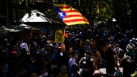 Pro-independence demonstrators gather during a protest against Spain's prime minister Pedro Sanchez outside the Gran Teatre del…
