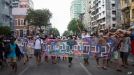 """Anti-coup protesters hold a slogan that reads """"Mountains and the main land are united."""" during a flash mob on Thursday, June 3,…"""