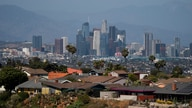 Homes sit on a hilltop with a view of the downtown Los Angeles skyline Thursday, June 10, 2021, in Los Angeles. (AP Photo/Jae C…