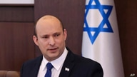 Israeli Prime Minister Naftali Bennett chairs the first weekly cabinet meeting of the new government in Jerusalem, Sunday, June…