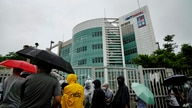 Media wait outside the Apple Daily headquarters in Hong Kong, Wednesday, June 23, 2021. Hong Kong's pro-democracy Apple Daily…