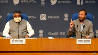 FILE - In this Thursday, Feb. 25, 2021, file photo, India's Information Technology Minister Ravi Shankar Prasad, left, and…