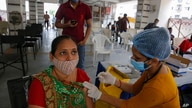 An Indian woman gets inoculated against COVID—19 at a vaccination center in Ahmedabad, India, Friday, July 30, 2021. (AP Photo…