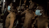 A group of migrants arrive outside a holding centre for migrants the Spanish North African enclave of Melilla, Spain, Tuesday…