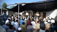 Afghan refugees offer Eid al-Adha prayers at a mosque in the Kazana Refugee camp on the outskirts of Peshawar, Pakistan,…