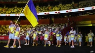 Olena Kostevych and Bogdan Nikishin, of Ukraine, carry their country's flag during the opening ceremony in the Olympic Stadium…