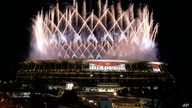 Fireworks illuminate over the National Stadium during the opening ceremony of the 2020 Summer Olympics, Friday, July 23, 2021,…