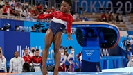 Simone Biles, of the United States, lands from the vault during the artistic gymnastics women's final at the 2020 Summer…