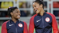 FILE - In this Aug. 9, 2016, file photo, U.S. gymnasts and gold medallists, Simone Biles, left and Gabrielle Douglas celebrate…