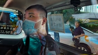 FILE - In this July 6, 2020, file photo, Tong Ying-kit arrives at a court in a police van in Hong Kong. Hong Kong High Court…