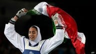 Kimia Alizadeh Zenoorin of Iran celebrates after winning the bronze medal in a women's Taekwondo 57-kgcompetition at the 2016…