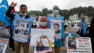 Members of Uyghur community living in Turkey stage a protest outside the Chinese consulate in Istanbul, Wednesday, June 2, 2021…