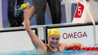 Ariarne Titmus, of Australia celebrates after winning the final of the women's 400-meters freestyle at the 2020 Summer Olympics…