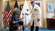 Dr. Brian Monahan, attending physician Congress of the United States, gives Speaker of the House Nancy Pelosi, D-Calif., a…