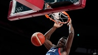 France's Moustapha Fall (93) dunks during men's basketball preliminary round game against Iran at the 2020 Summer Olympics,…