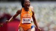 Marie-Josee Ta Lou, of the Ivory Coast, wins a heat in the women's 100-meter run at the 2020 Summer Olympics, Friday, July 30,…