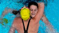 Kaylee McKeown, of Australia, is congratulated by teammate Emily Seebohm after winning the final of the women's 100-meter…