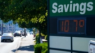 A display at an Olympia Federal Savings branch shows a temperature of 107 degrees Fahrenheit, Monday, June 28, 2021, in the…